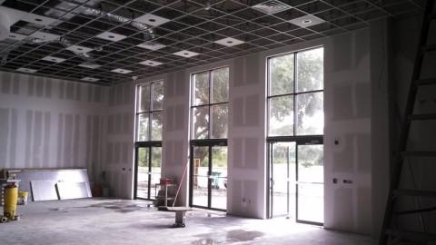 Repairing and replacing windows doors glass and garage for Garage door repair merritt island fl